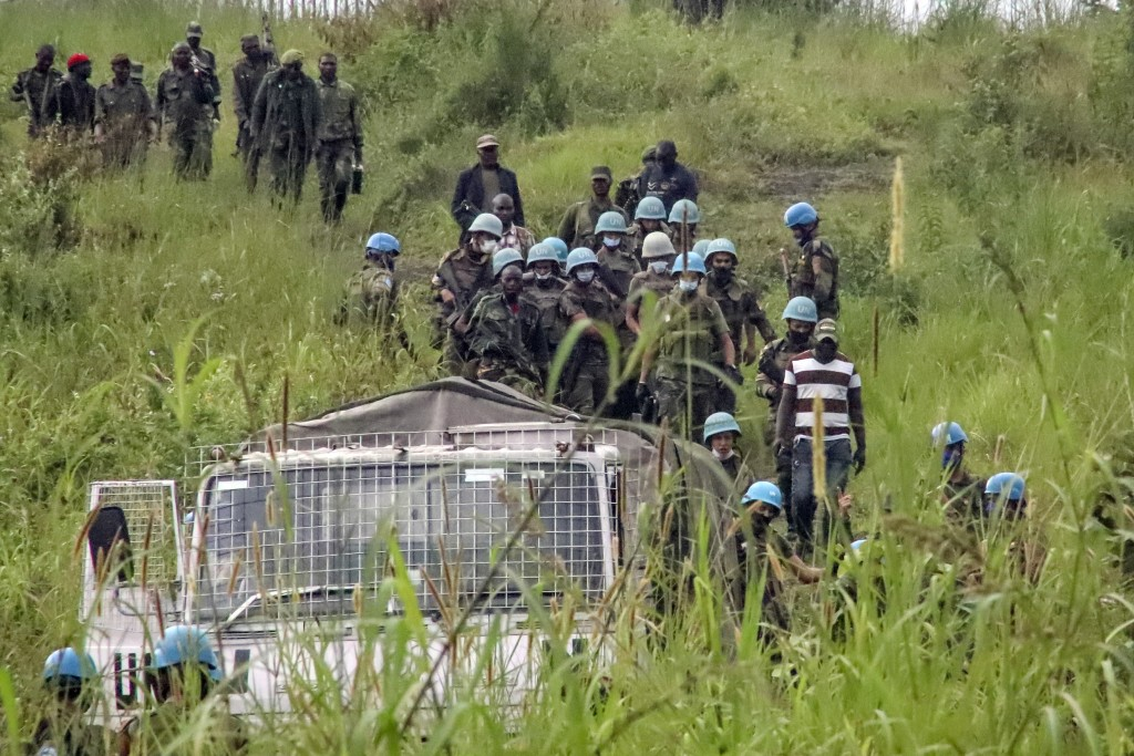 United Nations peacekeepers remove bodies from an area near to where a U.N. convoy was attacked and the Italian ambassador to Congo killed, in Nyirago...