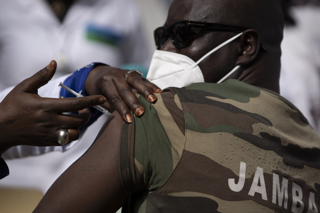 A member of the Army Forces receives a dose of the China's Sinopharm vaccine during the start of the vaccination campaign against the COVID-19 at the ...