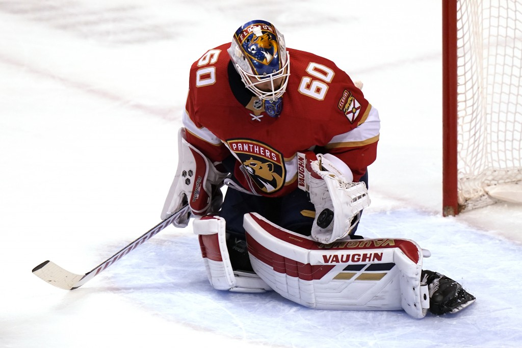 Florida Panthers goaltender Chris Driedger (60) stops the puck during the first period of an NHL hockey game against the Dallas Stars, Monday, Feb. 22...