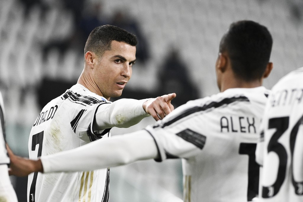 Juventus' Cristiano Ronaldo, left, celebrates after scoring during the Serie A soccer match between Juventus and Crotone, at the Allianz Stadium in Tu...