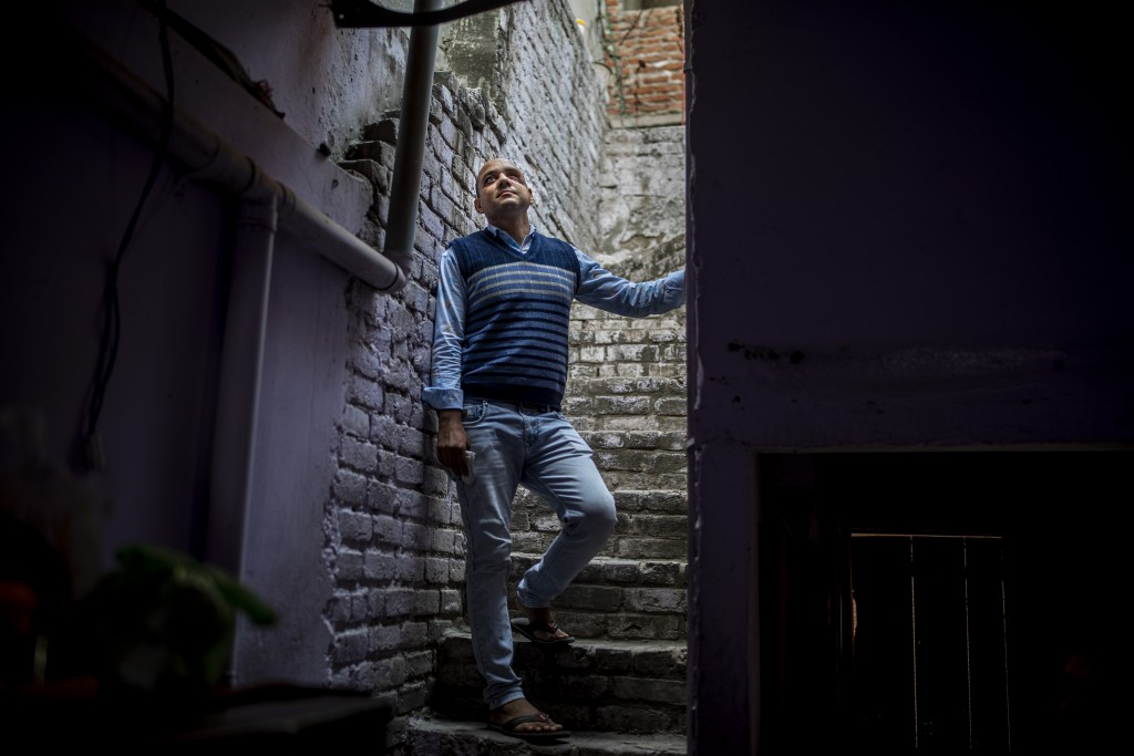 Muhammad Nasir Khan, who was shot by a Hindu mob during the February 2020 communal riots, is seen inside his home in North Ghonda, one of the worst ri...