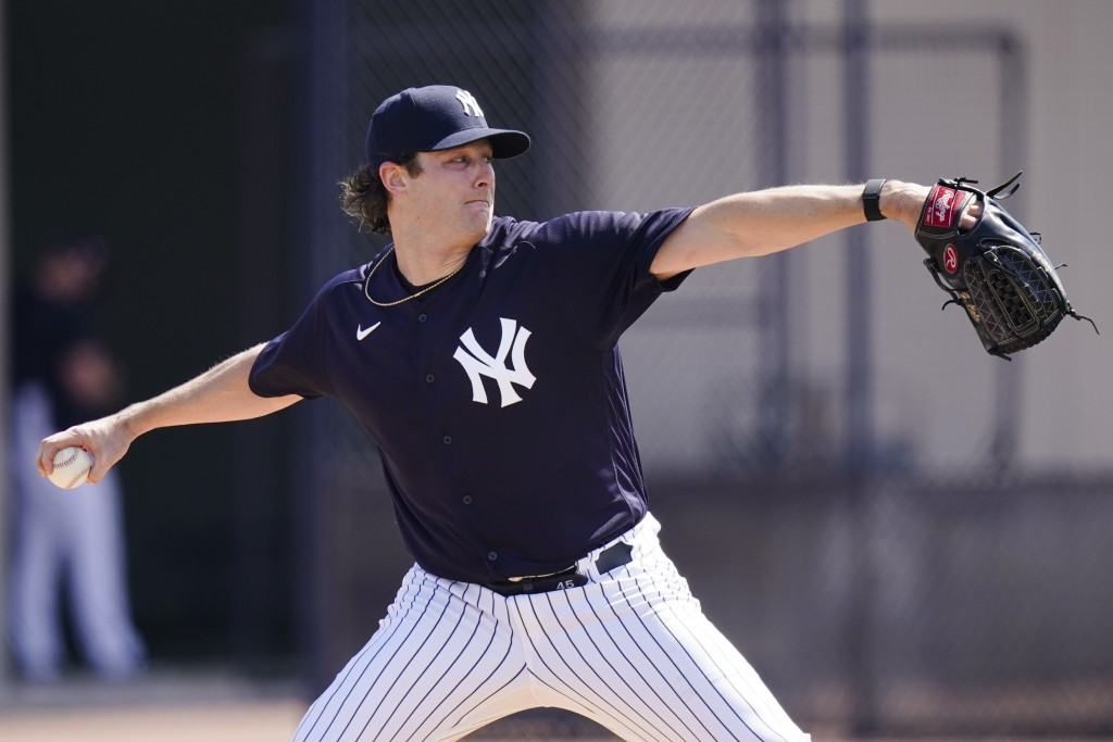 New York Yankees' Gerrit Cole delivers a pitch during a spring training baseball workout Monday, Feb. 22, 2021, in Tampa, Fla. (AP Photo/Frank Frankli...