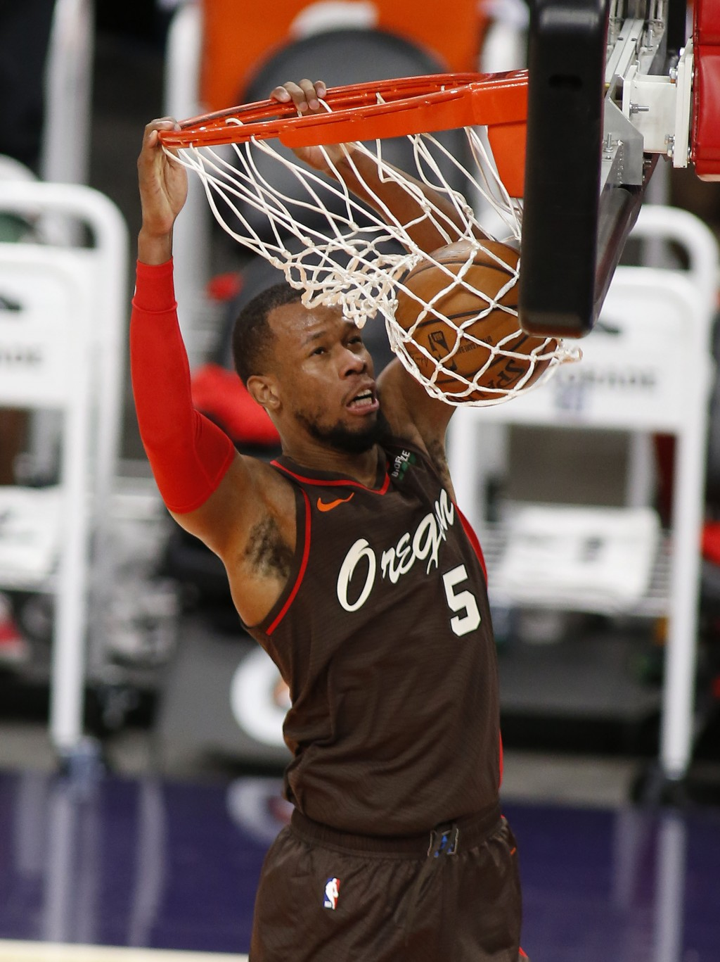 Portland Trail Blazers' Rodney Hood slams the ball home after stealing the ball during the first half of an NBA basketball game Monday, Feb. 22, 2021,...