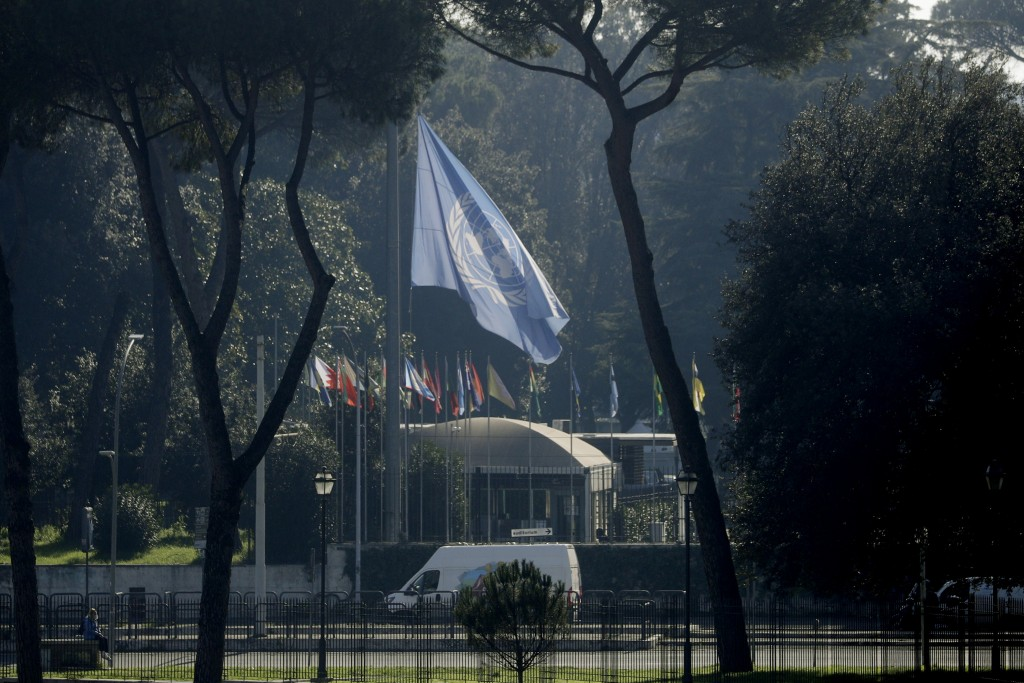 A flag of the FAO, United Nation's Food and Agriculture Organization, flies at half mast outside the FAO headquarters in Rome Tuesday, Feb. 23, 2021. ...