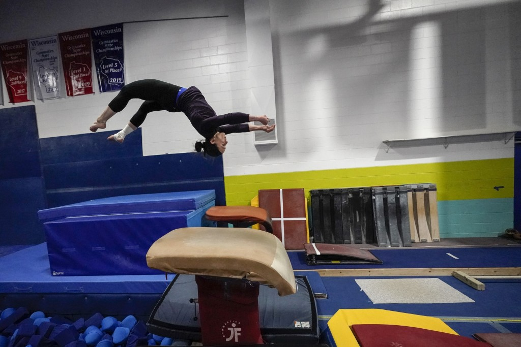 Former gymnastics world champion and Olympic silver medalist Chellsie Memmel works out Thursday, Feb. 18, 2021, in New Berlin, Wisc. Memmel started do...