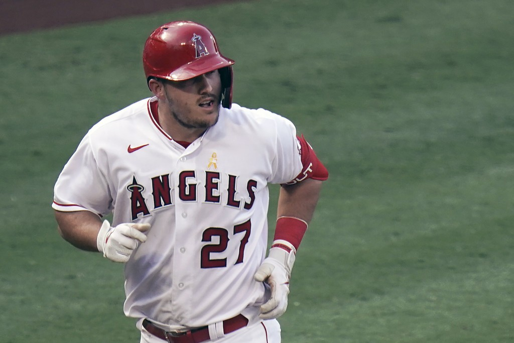 FILE - Los Angeles Angels' Mike Trout rounds the bases after hitting a two-run home run during the third inning of the first baseball game of a double...