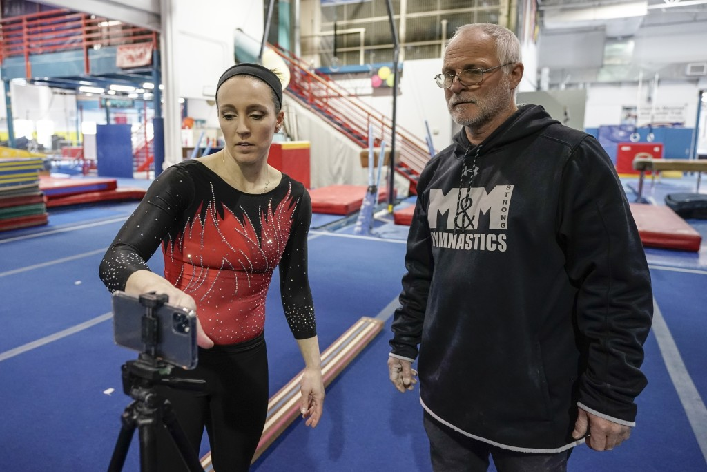 Former world champion and Olympic silver medalist Chellsie Memmel works out with her father and coach Andy Memmel Thursday, Feb. 18, 2021, in New Berl...