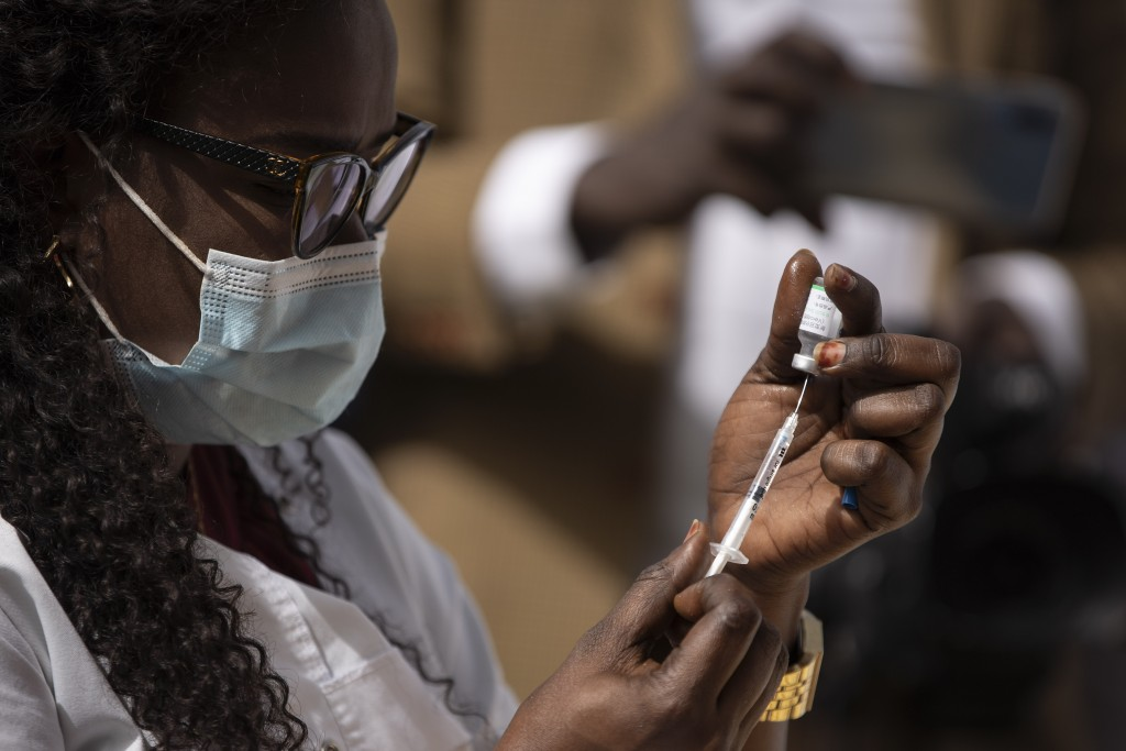 A health worker prepares a dose of the China's Sinopharm vaccine during the start of the vaccination campaign against the COVID-19 at the Health Minis...