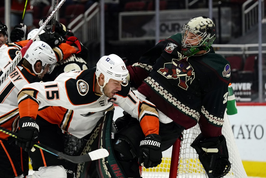 Anaheim Ducks center Ryan Getzlaf (15) hits Arizona Coyotes goaltender Darcy Kuemper (35) in the first period during an NHL hockey game, Monday, Feb. ...