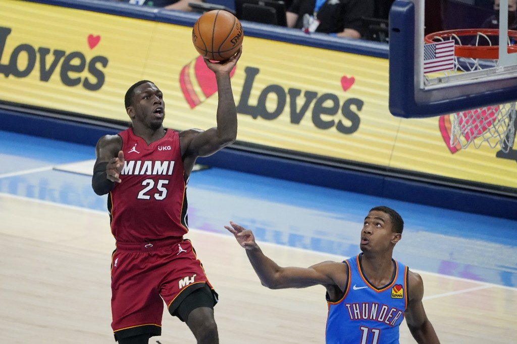 Miami Heat guard Kendrick Nunn (25) goes up for a shot in front of Oklahoma City Thunder guard Theo Maledon (11) in the second half of an NBA basketba...