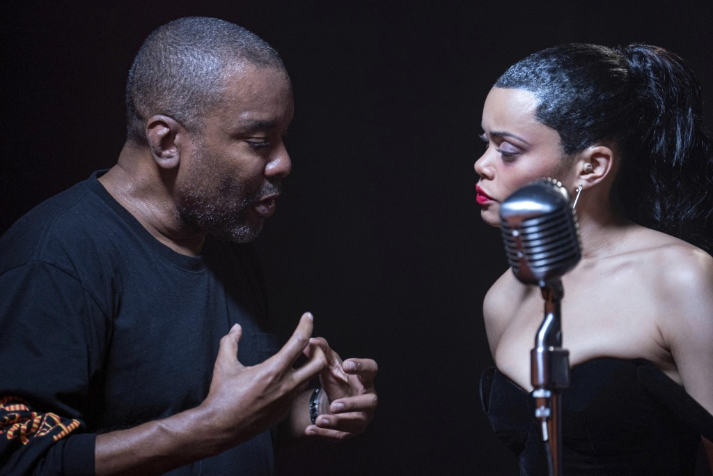 """This image released by Hulu shows director Lee Daniels, left, with Andra Day on the set of """"The United States vs. Billie Holiday."""" (Takashi Seida/Hulu..."""