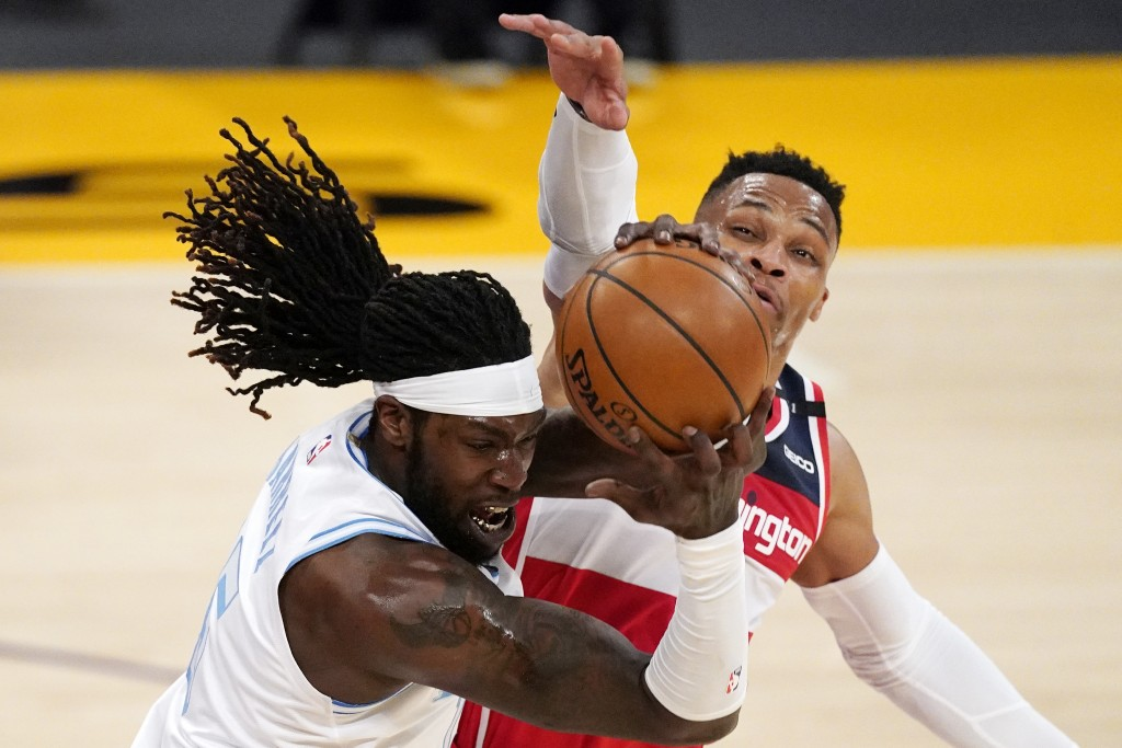 Los Angeles Lakers center Montrezl Harrell, left, grabs a loose ball away from Washington Wizards guard Russell Westbrook during the first half of an ...