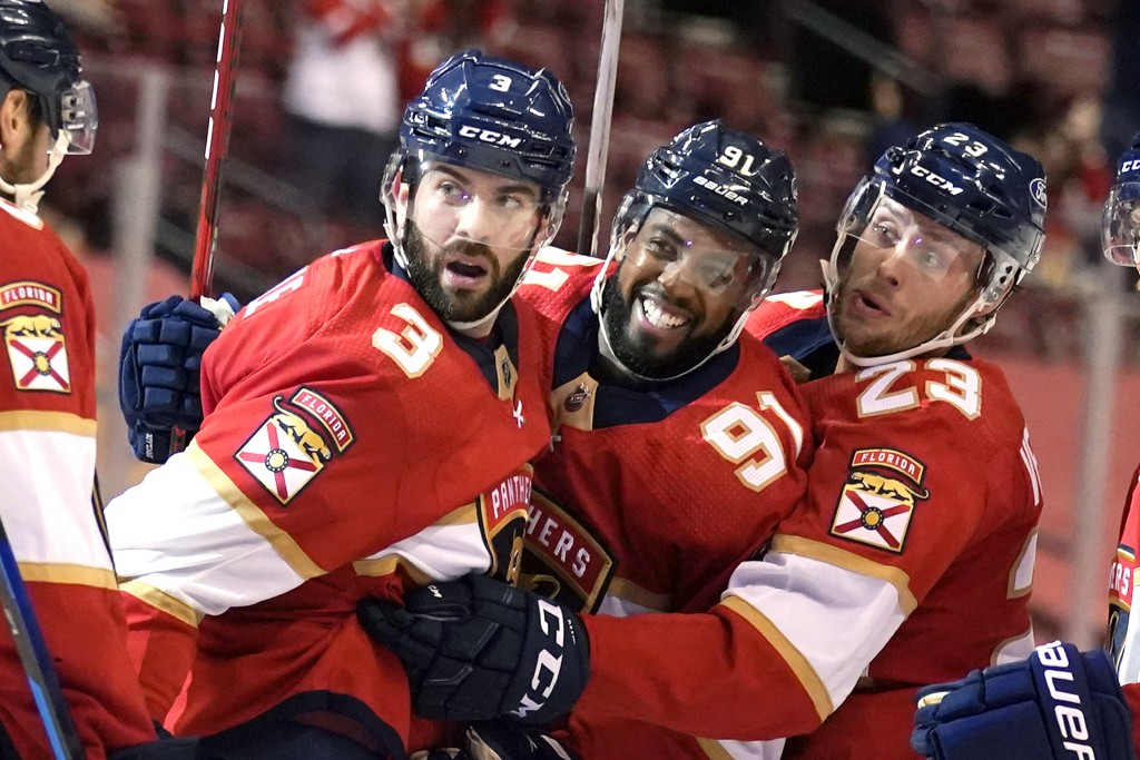 Florida Panthers defenseman Keith Yandle (3) celebrates with left wing Anthony Duclair (91) and center Carter Verhaeghe (23) after scoring a goal duri...