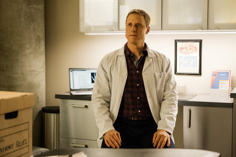 """This image released by SYFY shows Alan Tudyk as Harry Vanderspeigle in the new series """"Resident Alien."""" (James Dittinger/SYFY via AP)"""