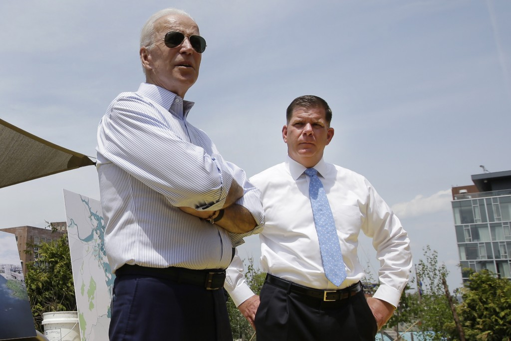FILE - In this June 5, 2019, file photo, then- Democratic presidential candidate Joe Biden, led, stands with Boston Mayor Marty Walsh, right, during a...