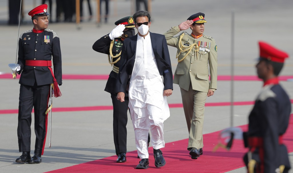Pakistan's Prime Minister Imran Khan inspects a Guard of Honor upon his arrival in Colombo, Sri Lanka, Tuesday, Feb. 23, 2021. Khan is in Sri Lanka fo...