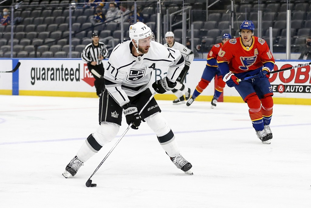 Los Angeles Kings' Jeff Carter (77) handles the puck while under pressure from St. Louis Blues' Brayden Schenn (10) during the first period of an NHL ...