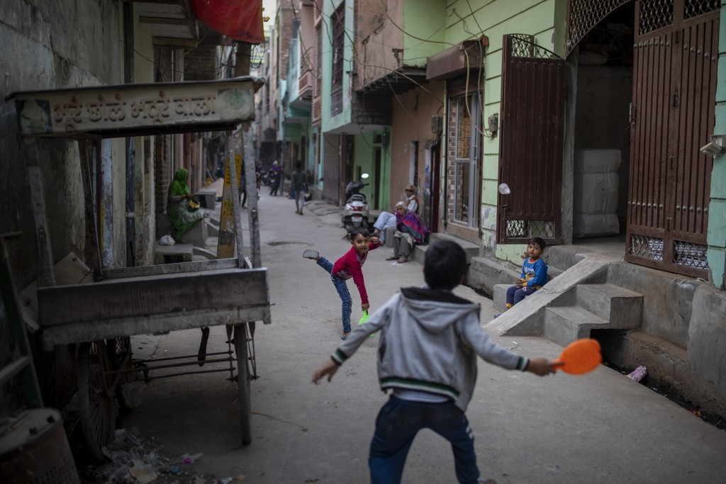 Children play in an alleyway in North Ghonda neighborhood, one of the worst riot affected area during the February 2020 communal riots, in New Delhi, ...