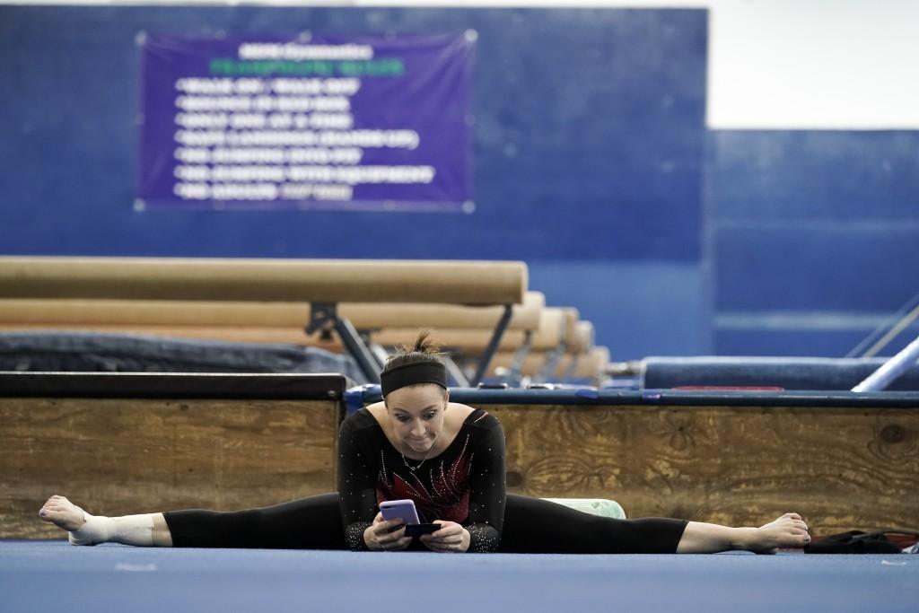 Chellsie Memmel works out Thursday, Feb. 18, 2021, in New Berlin, Wisc. Memmel started doing gymnastics again when the COVID-19 pandemic hit last spri...