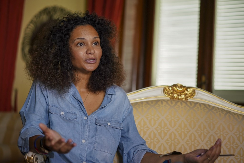 FILE - In this Aug. 13, 2020 file photo, fashion designer Stella Jean talks during an interview with the Associated Press, in Rome. A digital runway s...