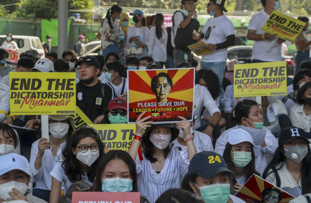 Anti-coup protesters display pictures of deposed Myanmar leader Aung San Suu Kyi during a protest in Yangon, Myanmar Tuesday, Feb. 23, 2021. Protester...
