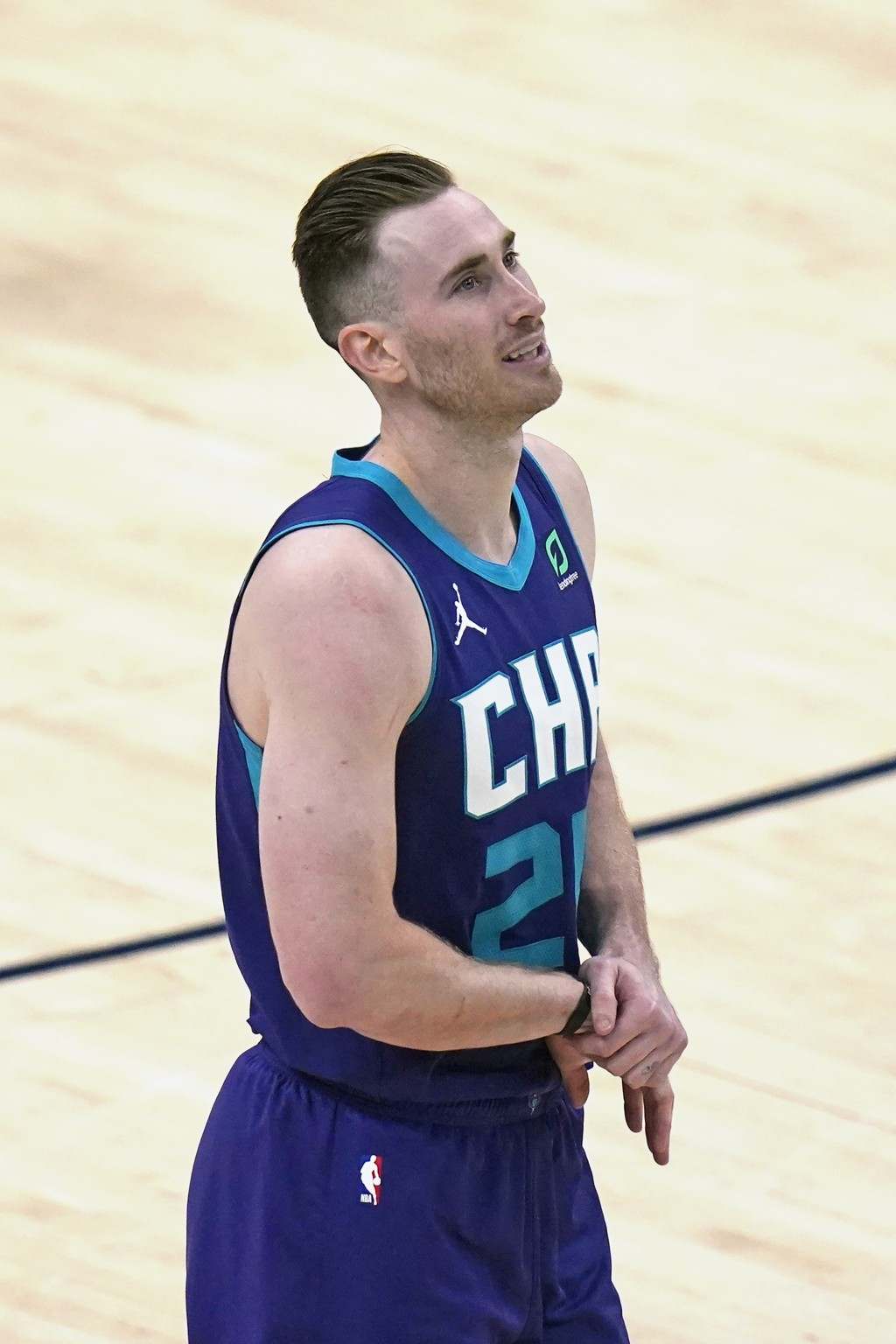 Charlotte Hornets forward Gordon Hayward (20) walks off the court after injuring his right wrist in the second half during an NBA basketball game agai...