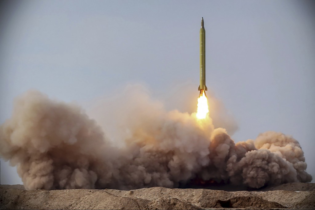 FILE - In this file photo released Jan. 16, 2021, by the Iranian Revolutionary Guard, a missile is launched in a drill in Iran. The Biden administrati...