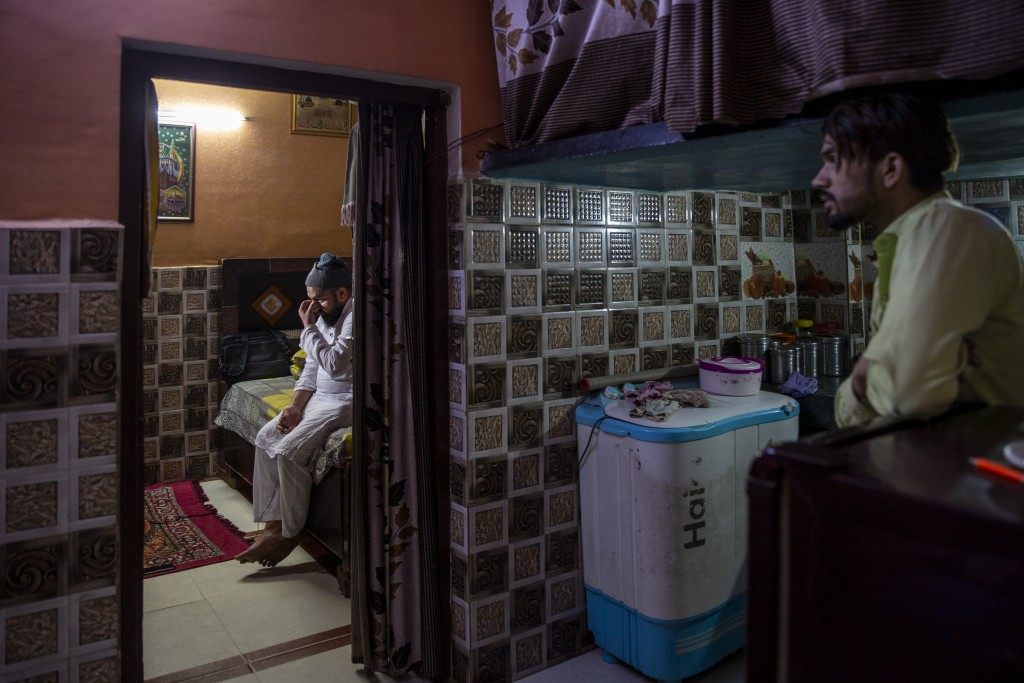 Haroon, left, who saw his 32 year-old brother being shot and killed by his Hindu neighbors during the February 2020 communal riots, breaks down while ...