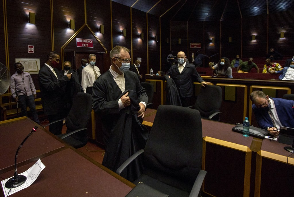 Legal teams arrive at the High Court in Pietermaritzburg, South Africa, Tuesday, Feb. 23, 2021. A South African judge said he will file a criminal com...