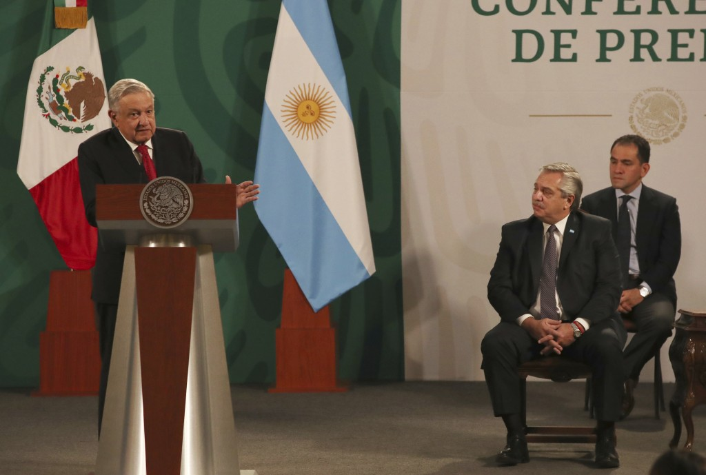 Argentina's President Alberto Fernández, front right, attends Mexican President Andrés Manuel López Obrador's daily, morning press conference at the N...