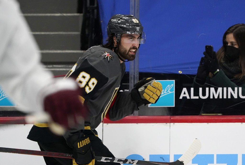 Vegas Golden Knights right wing Alex Tuch, back, reacts after scoring a goal against the Colorado Avalanche in the second period of an NHL hockey game...