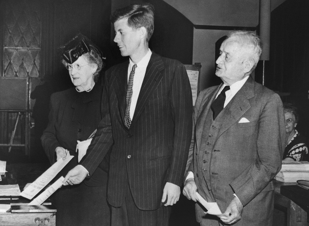 FILE - In this June 18, 1946, file photo, Democrat congressional candidate John F. Kennedy, center, casts his vote beside his grandparents Mary Joseph...