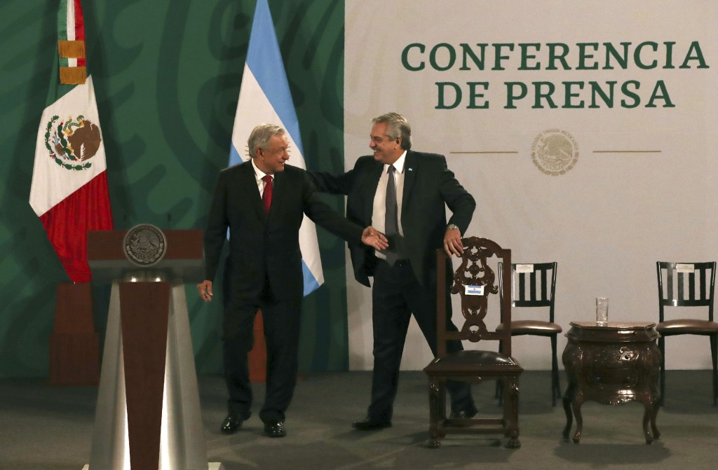 Argentina's President Alberto Fernández, right, arrives with Mexican President Andrés Manuel López Obrador for the Mexican president's daily, morning ...