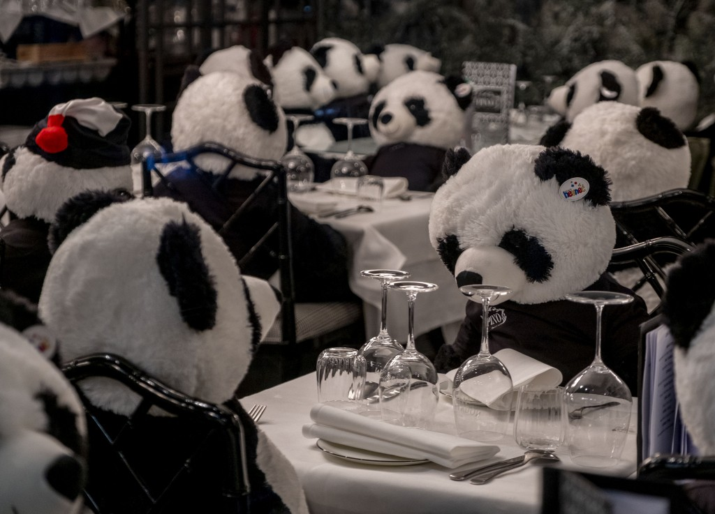 The owner of a closed restaurant has placed plush panda bears at the tables in central Frankfurt, Germany, Tuesday, Feb. 23, 2021, as Germany is still...