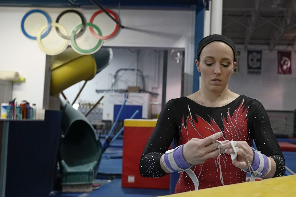 Former gymnastics world champion and Olympic silver medalist Chellsie Memmel works out Thursday, Feb. 18, 2021, in New Berlin, Wisc. The 32-year-old m...