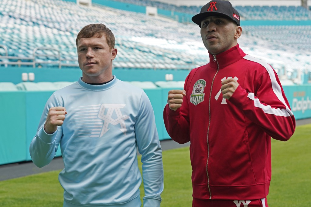 "Boxers Saul ""Canelo"" Alvarez, left, and Avni Yildirim pose for photos at Hard Rock Stadium, Monday, Feb. 22, 2021, in Miami Gardens, Fla. Alvarez will..."