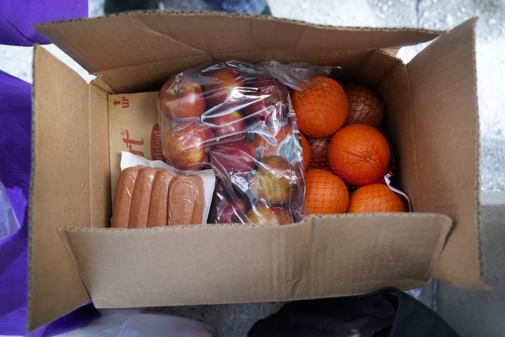 A USDA Farmers to Families Food Box is seen at a Des Moines Area Religious Council mobile food pantry stop at the downtown bus station, Thursday, Feb....