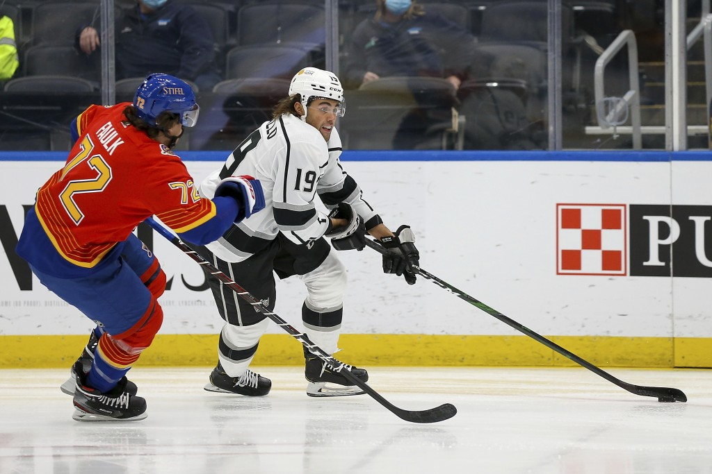 Los Angeles Kings' Alex Iafallo (19) controls the puck in front of St. Louis Blues' Justin Faulk (72) during the first period of an NHL hockey game Mo...