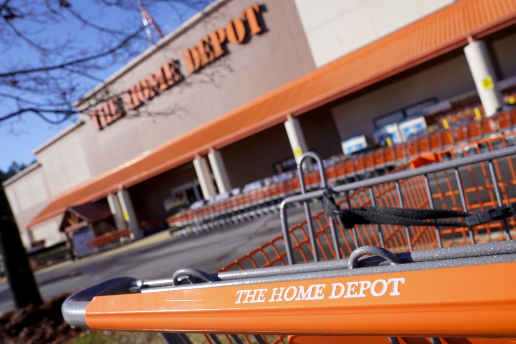 Shopping carts are lined up at The Home Depot store on Monday, Feb. 22, 2021, in Cornelius, N.C. The Home Depot's fiscal fourth-quarter sales surged 2...