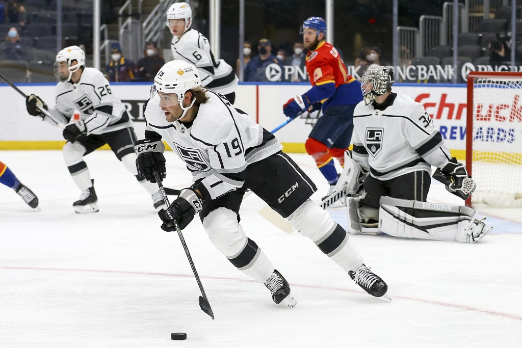 Los Angeles Kings' Alex Iafallo (19) drives the puck down the ice during the second period of an NHL hockey game against the St. Louis Blues Monday, F...