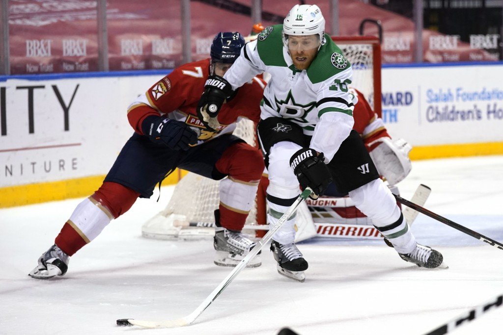 Dallas Stars center Joe Pavelski (16) goes for the puck as Florida Panthers defenseman Radko Gudas (7) defends during the third period of an NHL hocke...