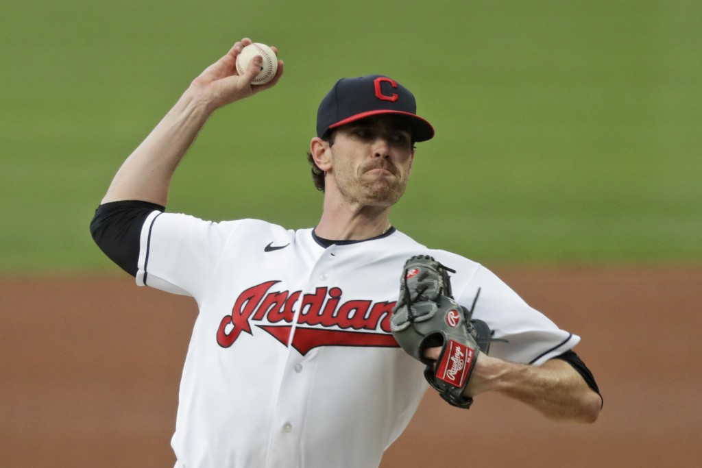 FILE - Cleveland Indians starting pitcher Shane Bieber delivers in the first inning in a baseball game against the Minnesota Twins in Cleveland, in th...