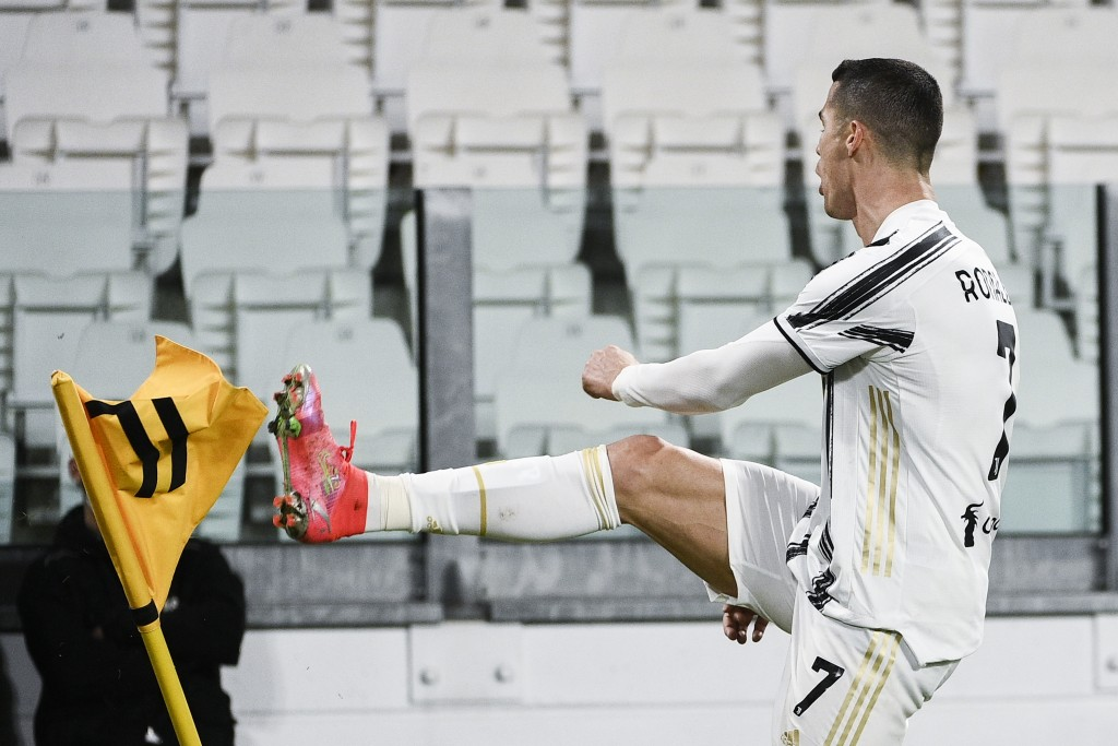 Juventus' Cristiano Ronaldo celebrates after scoring during the Serie A soccer match between Juventus and Crotone, at the Allianz Stadium in Turin, It...