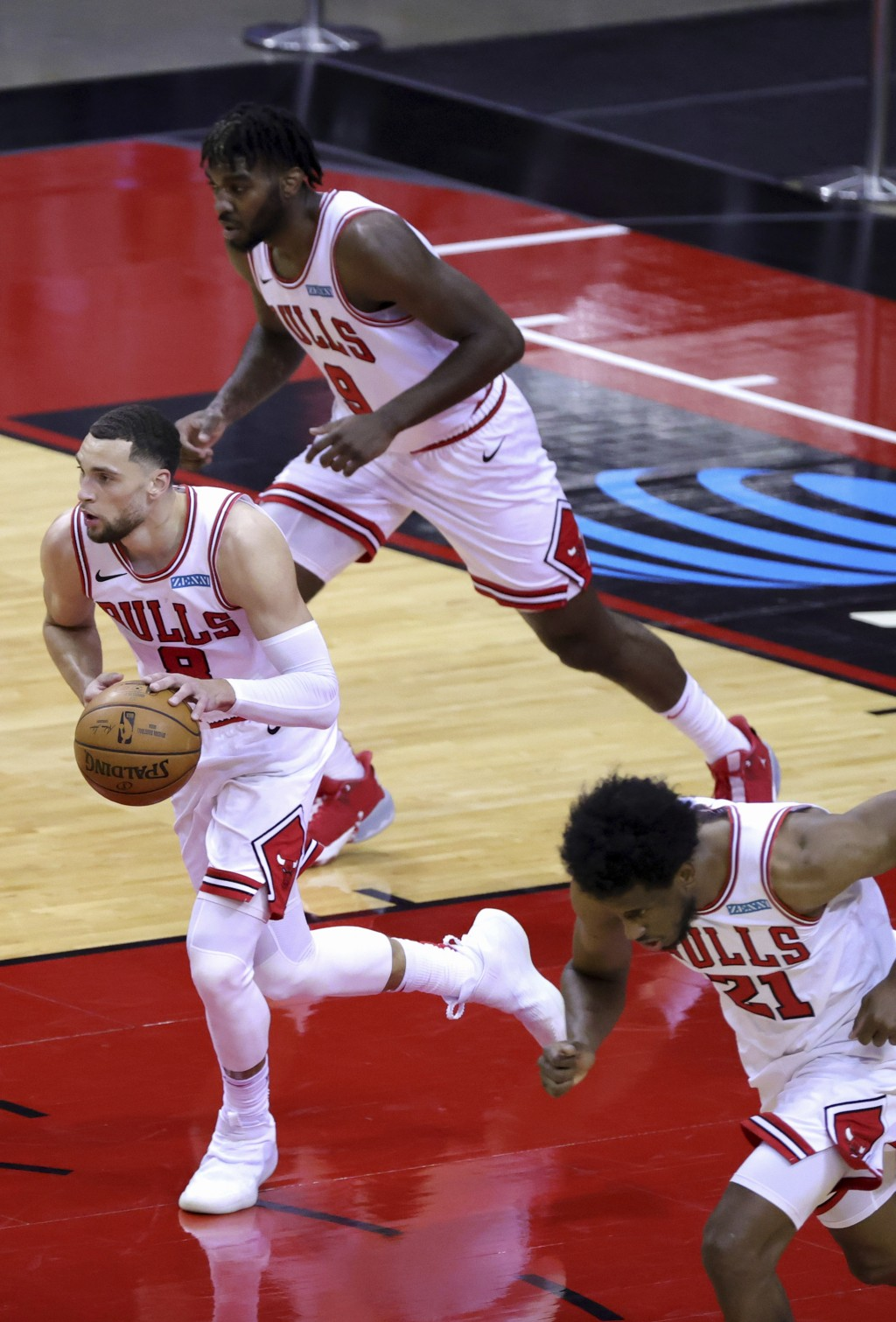 Chicago Bulls'  Zach LaVine, left, heads upcourt with the ball during the third quarter of an NBA basketball game against the houston RocketsMonday, F...