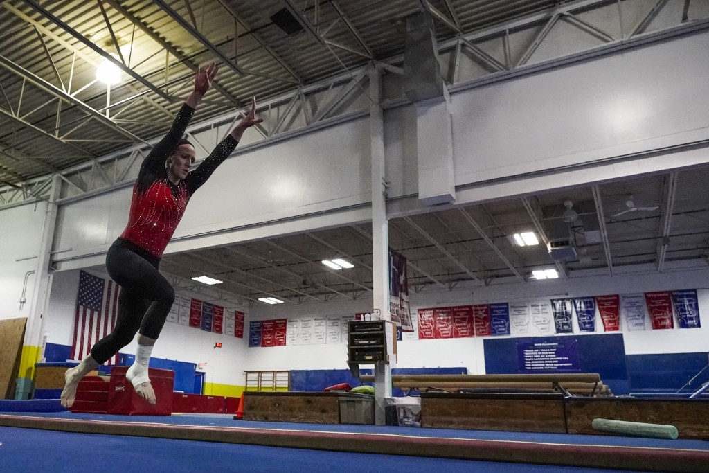Former gymnastics world champion and Olympic silver medalist Chellsie Memmel works out Thursday, Feb. 18, 2021, in New Berlin, Wisc. The married mothe...