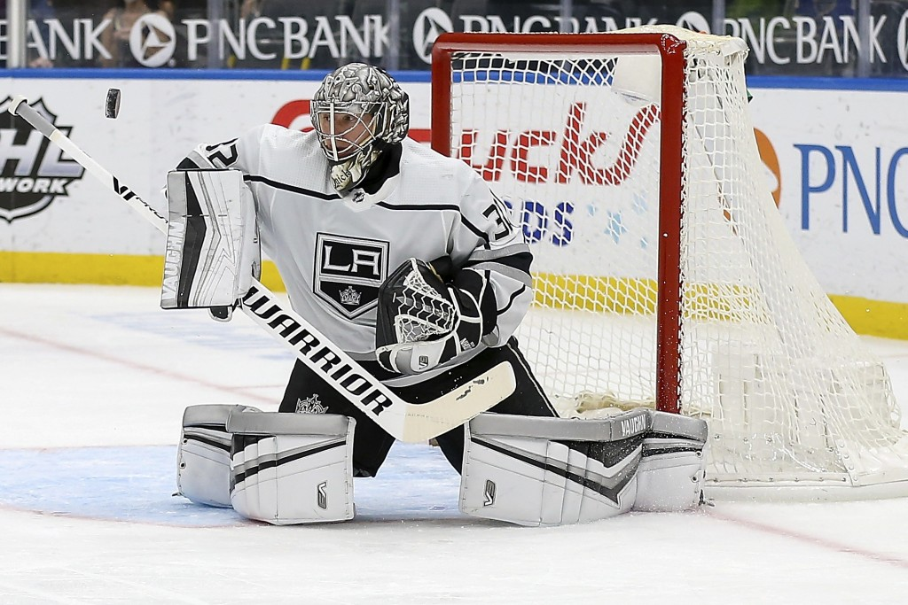 Los Angeles Kings' goaltender Jonathan Quick (32) deflects the puck during the second period of an NHL hockey game against the St. Louis Blues, Monday...