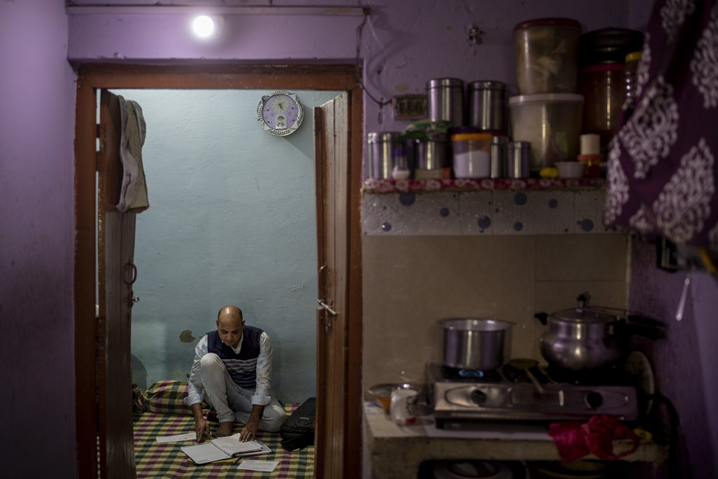Muhammad Nasir Khan, who was shot by a Hindu mob during the February 2020 communal riots, sifts through his legal and medical files inside his home in...