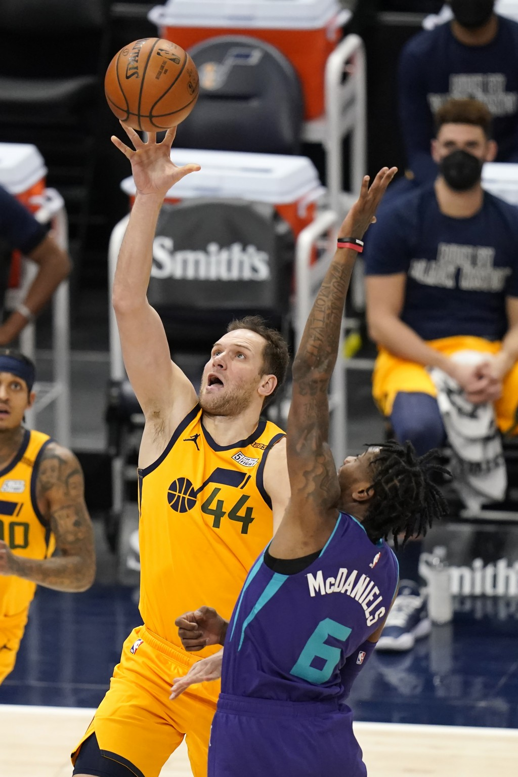 Utah Jazz forward Bojan Bogdanovic (44) lays the ball up as Charlotte Hornets forward Jalen McDaniels (6) defends in the first half during an NBA bask...