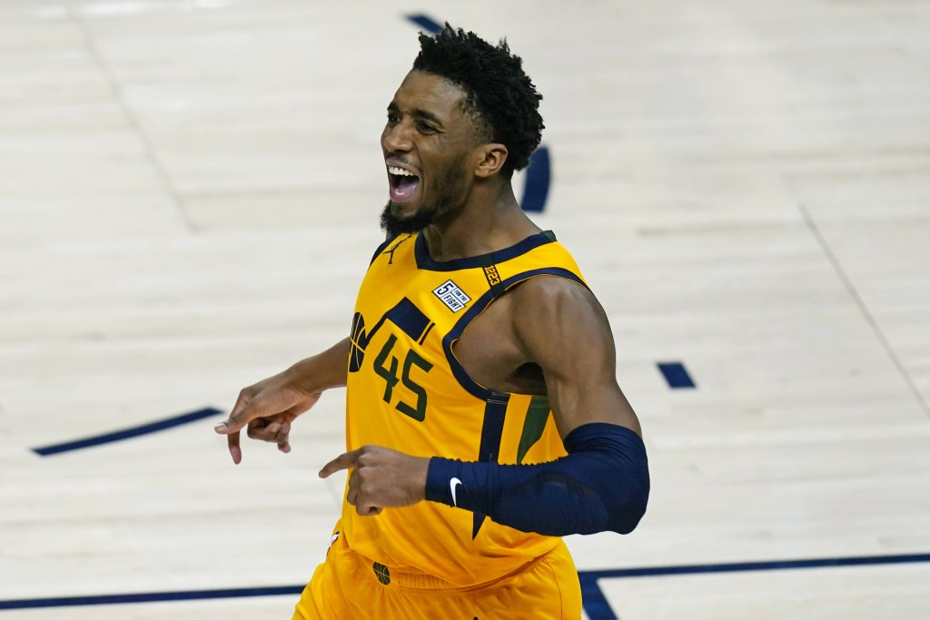 Utah Jazz guard Donovan Mitchell (45) reacts after scoring against the Charlotte Hornets in the second half during an NBA basketball game Monday, Feb....