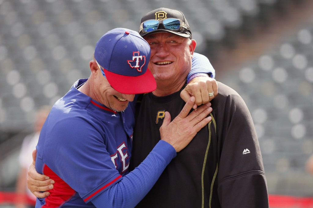 FILE - In this May 27, 2016, file photo, Texas Rangers manager Jeff Banister, left, and Pittsburgh Pirates manager Clint Hurdle greet each other durin...
